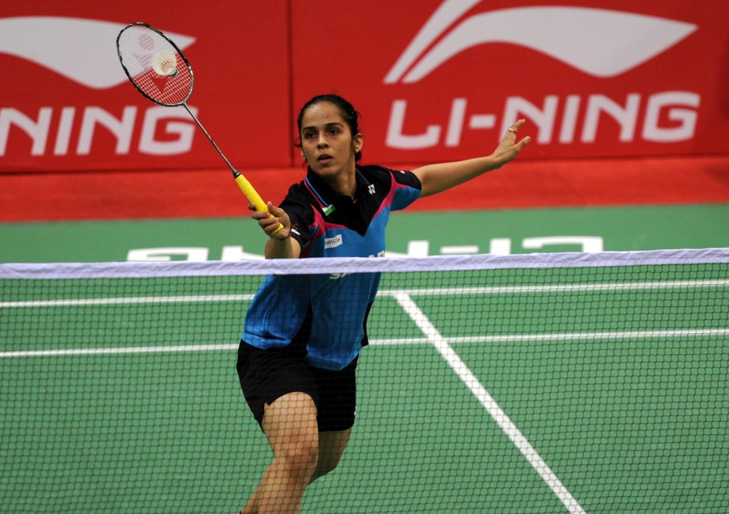 Indian Badminton player Saina Nehwal in action against her Canadian counterpart Joycelyn Ko  during a Thomas Cup and Uber Cup match at Siri Fort Stadium in New Delhi on May 18, 2014. (Photo: IANS)