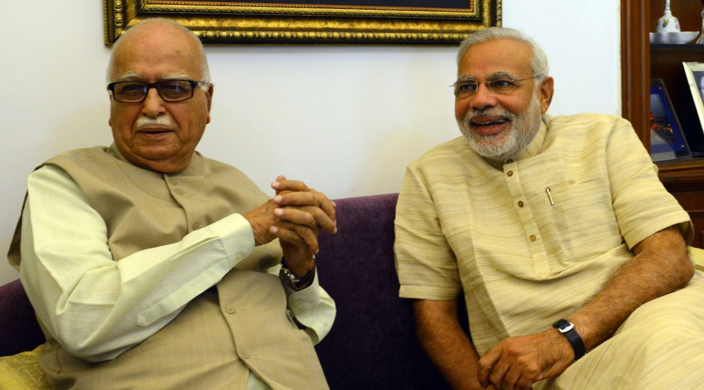 BJP Prime Ministerial candidate Narendra Modi during a meeting with party veteran L K Advani