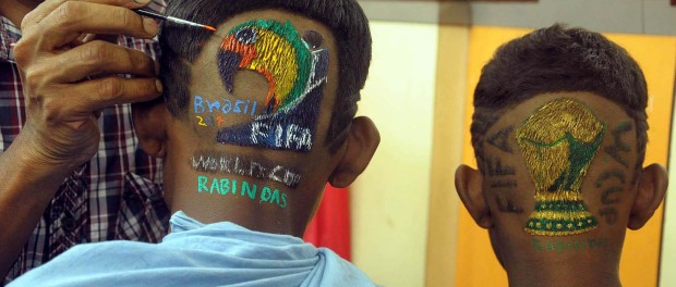 A football fan with a FIFA World Cup hair cut at Howrah in West Bengal on June 14, 2014. (Photo: Kuntal Chakrabarty/IANS)